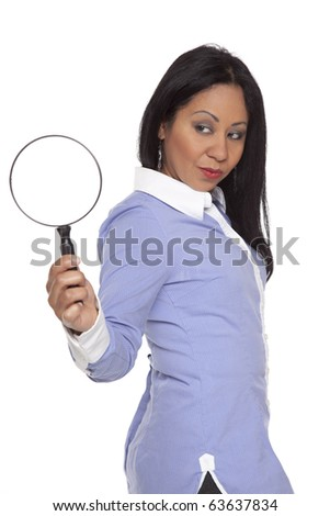 Isolated studio shot of a Latina businesswoman looking at a magnifying glass. - stock photo