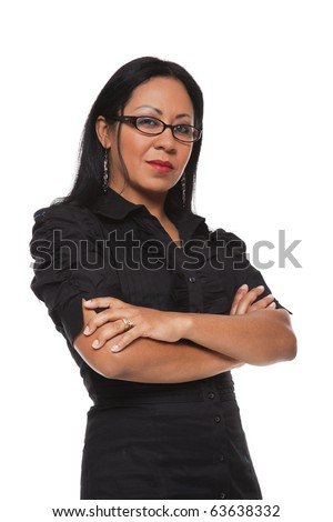 Isolated studio shot of a Latina businesswoman looking at the camera with a stern expression. - stock photo