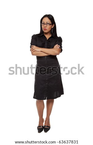 Isolated studio shot of a Latina businesswoman with a stern expression looking at the camera disapprovingly. - stock photo