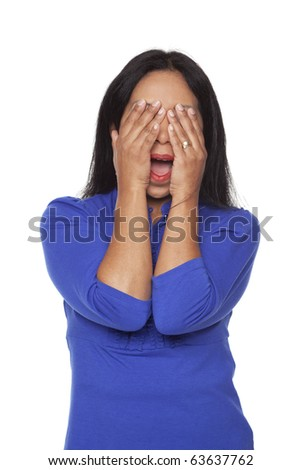 Isolated studio shot of a Latina woman in the See No Evil pose. - stock photo