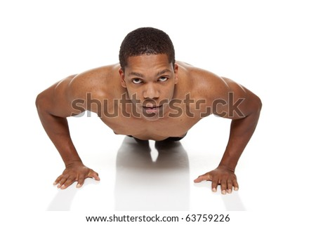 Isolated studio shot of a muscular man doing push ups - stock photo