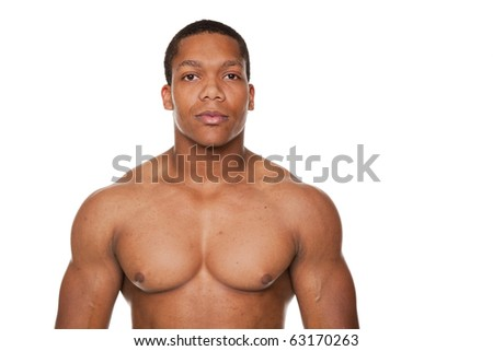 Isolated studio shot of a muscular man looking at the camera. - stock photo