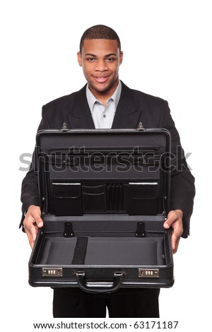 Isolated studio shot of a smiling African American businessman holding an open briefcase as if it contained something valuable. - stock photo