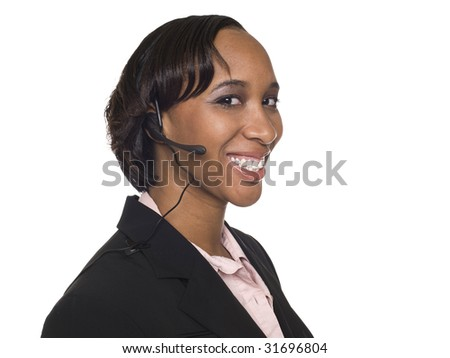 Isolated studio shot of a smiling businesswoman talking on a customer service telephone headset.