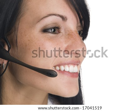 Isolated studio shot of a smiling telephone operator or receptionist.