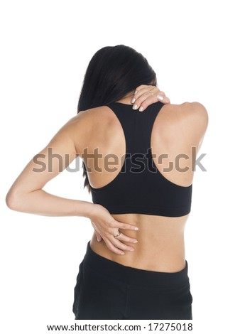 Isolated studio shot of a woman in a fitness outfit experiencing neck, shoulder  and back pain.