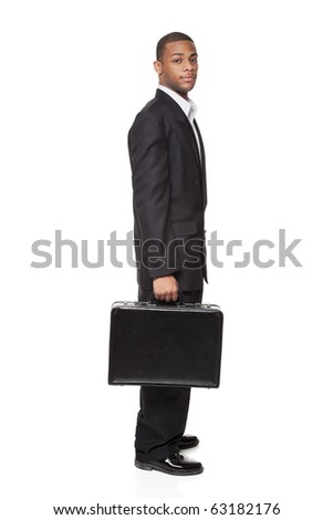 Isolated studio shot of an African American businessman holding a nice briefcase. - stock photo