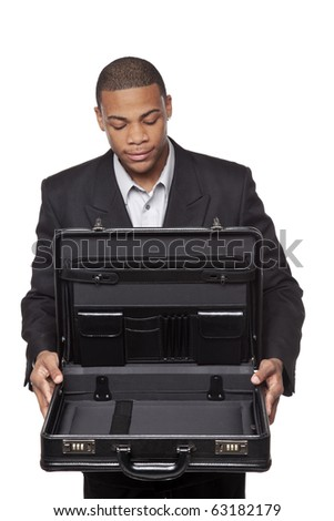 Isolated studio shot of an African American businessman holding an open briefcase as if it contained something valuable. - stock photo