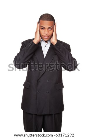 Isolated studio shot of an African American businessman in the Hear No Evil pose. - stock photo