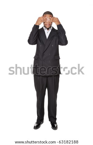 Isolated studio shot of an African American businessman in the See No Evil pose. - stock photo