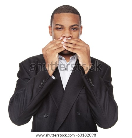Isolated studio shot of an African American businessman in the Speak No Evil pose. - stock photo