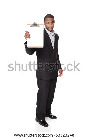 Isolated studio shot of an African American businessman presenting a blank clipboard to the camera. - stock photo