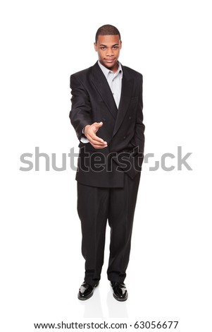 Isolated studio shot of an African American businessman reaching out to shake hands. - stock photo