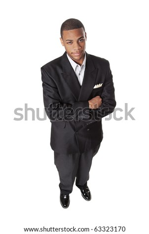 Isolated studio shot of an African American businessman viewed from a high angle. - stock photo