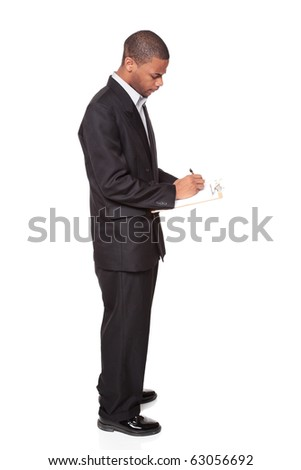 Isolated studio shot of an African American businessman writing on a clipboard. - stock photo
