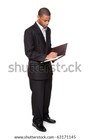 Isolated studio shot of an African American businessman writing on a nice notepad.