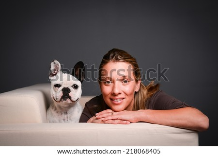 isolated studio shot of beautiful young woman with her pet little dog french bulldog - stock photo
