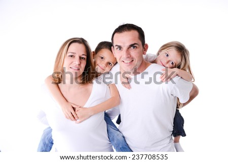 isolated studio shot of happy family of four with little children white background