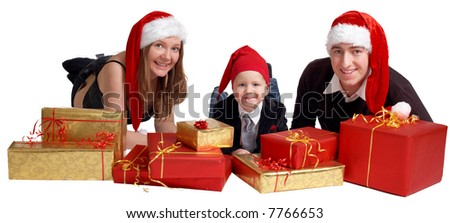 Isolated studio shot of happy young family of three wearing Santas hats with a lot of Christmas presents. - stock photo