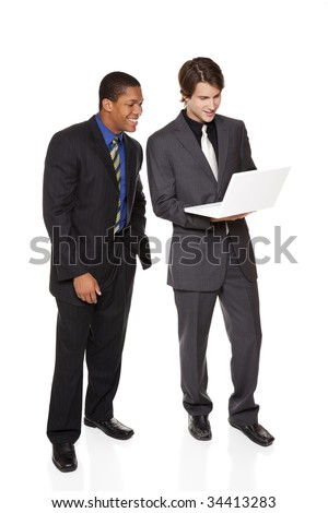 Isolated studio shot of two businessmen looking at a laptop and smiling. - stock photo