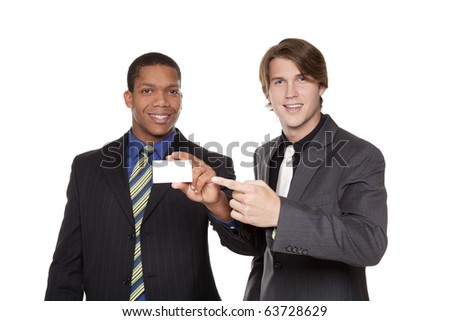 Isolated studio shot of two businessmen showing off their new business card. - stock photo