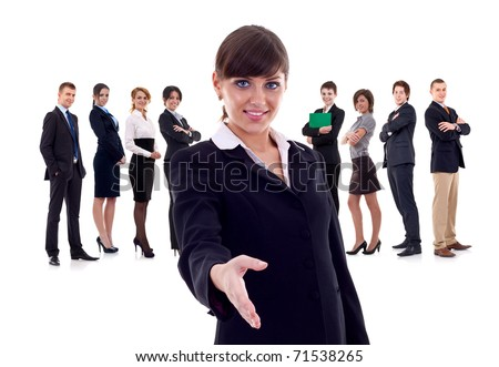 Isolated successful business team, focus on woman with handshake gesture. - stock photo