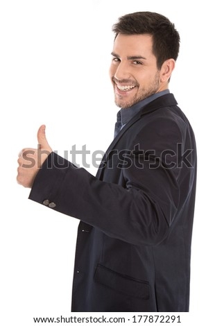 Isolated successful smiling young business man with thumb up. - stock photo