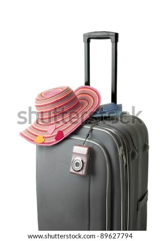 isolated suitcase with accessories - stock photo