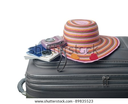 isolated suitcase with accessories horizontal version - stock photo