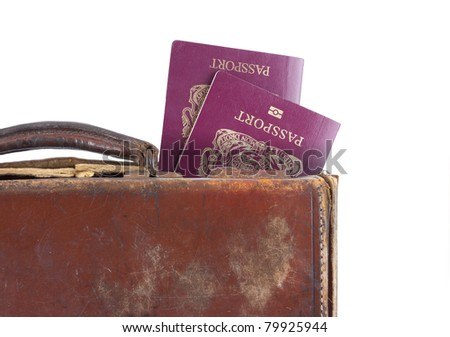 isolated suitcase with passports on a white background - stock photo
