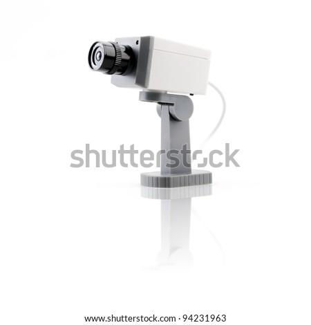 Isolated surveillance camera - stock photo