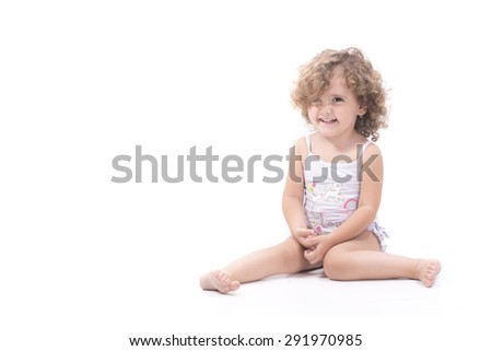 Isolated sweet female child sit and smiling over white background