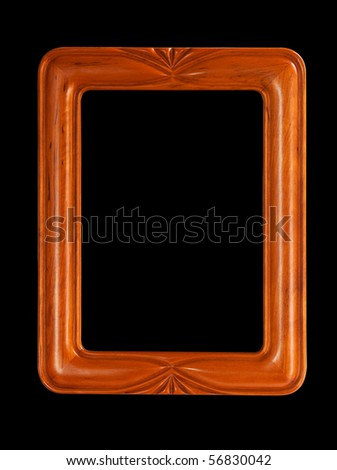 Isolated teak colored carved picture frame against black - stock photo