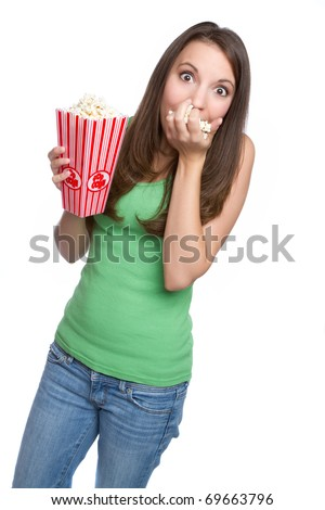 Isolated teenage girl eating popcorn - stock photo