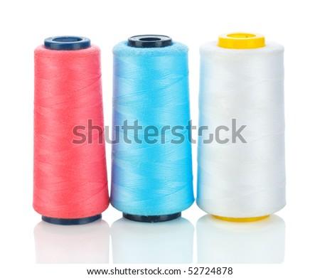 isolated three spool of thread - stock photo