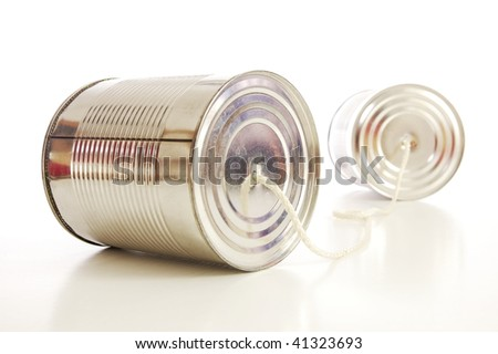 isolated tin or can telephone showing communication - stock photo