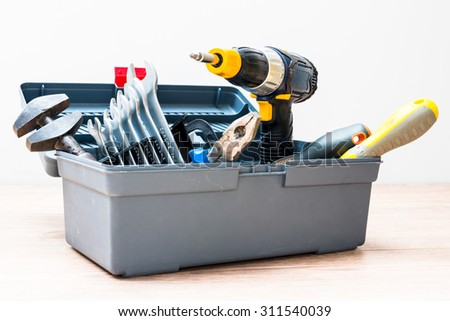 Isolated toolbox with variety of tools - stock photo