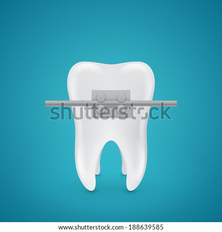 Isolated tooth with staples on blue background