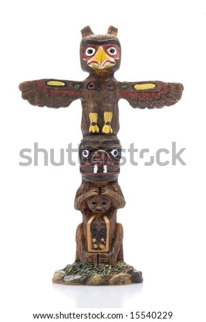 Isolated Totem Pole Statue - stock photo