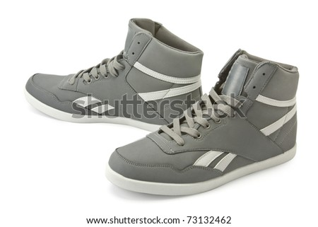 isolated trainers on a white background - stock photo