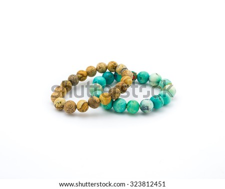isolated turquoise and brown bracelet stone on white background