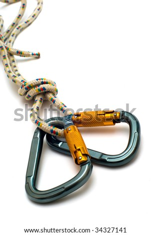 isolated two alpinism carabiners and rope - stock photo