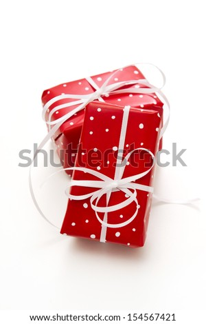 Isolated two giftbox wrapped in dotted paper red/white over white background.  - stock photo