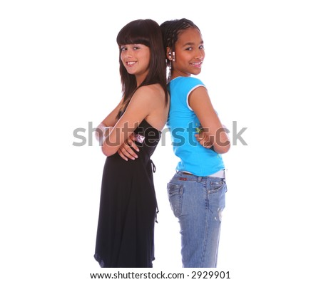 isolated two young girls lean back on each other close up - stock photo