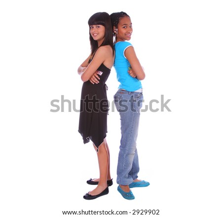 isolated two young girls lean back to each other - stock photo