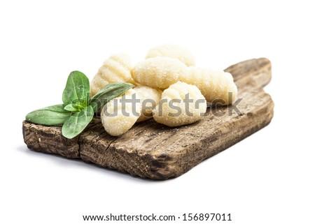 Isolated uncooked fresh gnocchi  - stock photo