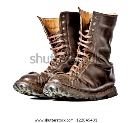 isolated used combat leather boots - stock photo