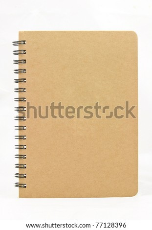 Isolated vertical recycle paper note book on white background - stock photo