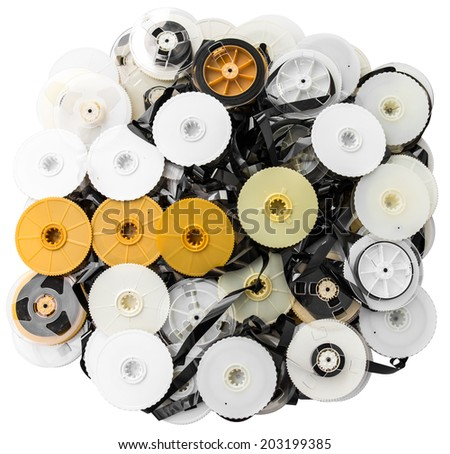 Isolated VHS tape that was disassembled into a pile together - stock photo