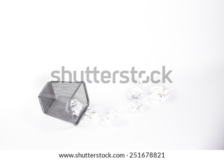 isolated wastebasket full of white waste paper - stock photo